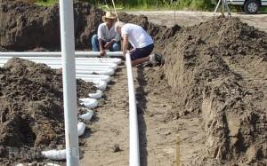Укладка труб для геотермального отопления дома
